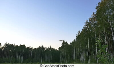 landing passenger plane in evening