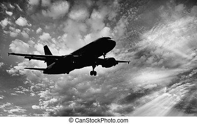 Landing plane at sunset