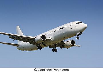 Landing plane - White clean plane landing in sunny day