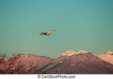 landing private airplane against the background of Caucasus mountains