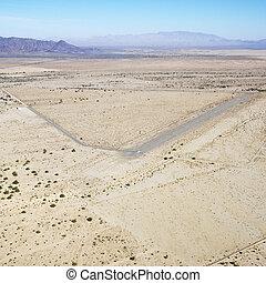 Landing strip in desert. - Aerial view of remote landing...