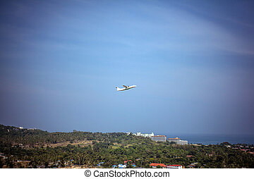 landing strip of the airport with airplane in the island
