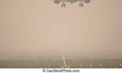 Landing. - Jet airplane landing, early morning.