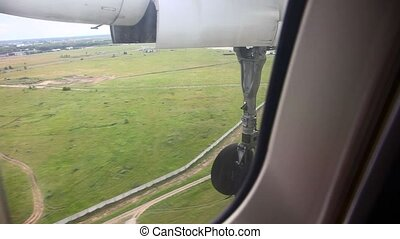 Landing. - View through the window turboprop aircraft during...