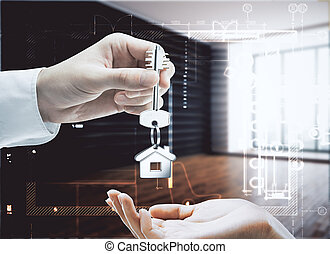 Landlord concept - Businessman handing key with house...