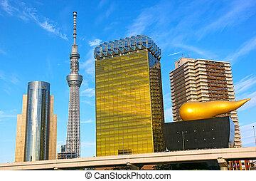 Landmark buildings line along Sumida River in Asakusa in...
