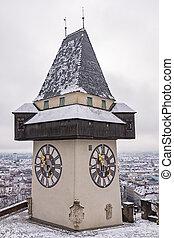 Landmark Uhrturm on hill Schlossberg in Graz on snowy...
