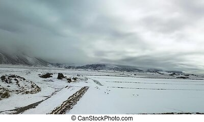 Landscape aerial footage snowcovered farmlands - Iceland...