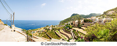 landscape and historic village against blue sea and sky on Mallorca