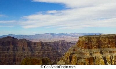 aerial view of grand canyon cliffs from helicopter -...