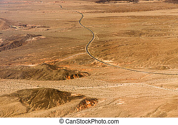 aerial view of road in grand canyon desert