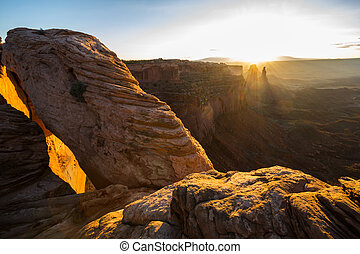 Landscape around the Mesa Arch at sunrise