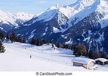 Landscape at Penken ski resort and snowy chalet
