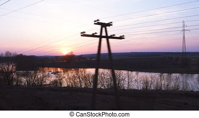 landscape at sunset from a moving train