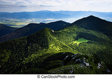 view of the valley on a mountain green saddle