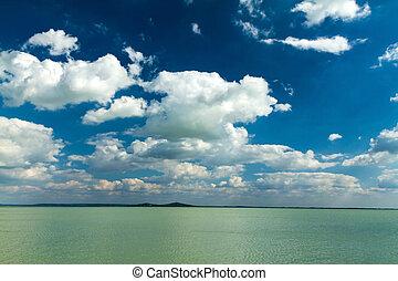 Beautiful lamb clouds above the lake
