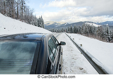 car on the winter mountainins road