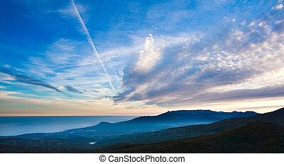 Landscape, clouds in evening sky