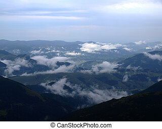 Landscape. Clouds in mountains valley. Carpatians