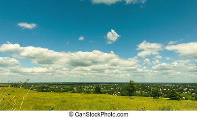 Landscape, clouds moving over a field with trees. Time Lapse...
