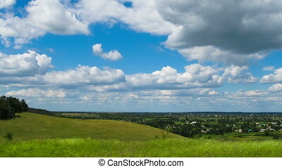 Landscape, clouds moving over a field with trees. - Lots of...