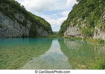 landscape consisting of mountains and lake. The Plitvice Lakes, national park in Croatia