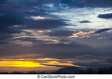Landscape Dramatic sunset and sunrise sky with a silhouette of trees