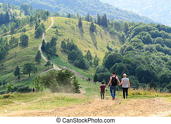 Landscape family travels tourists high up in the mountains
