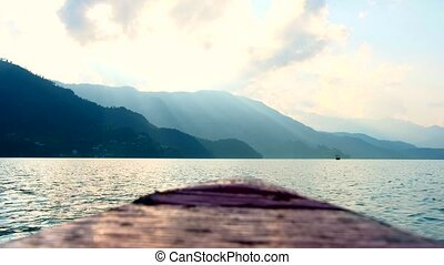 Landscape from the nose of a floating boat on Pheva lake in...