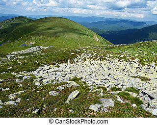Landscape. Hills, stones  and clouds. Carpatian mountains