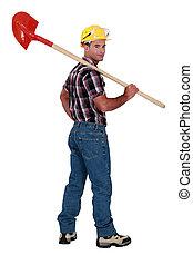 Landscape image of a craftsman with shovel