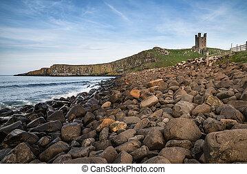 Landscape image of Dunstanburgh Castle on Northumberland...