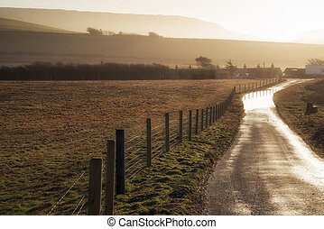 Landscape image of flooded country lane in farm