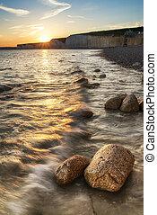 Landscape image of sunset over Birling Gap in England