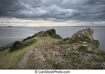 Landscape image of view out ot sea with stormy sky