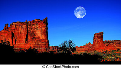 Landscape in Arches National Park with Full Moon