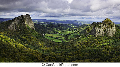 Beautiful rocky volcanic landscape in The Central Massif in France. The image represents The Tuiliere Rocks (left) and The Sanadoire Rocks (right) and between these there is The Chausse Valley.