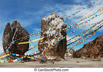 Landscape of huge rocks with colorful prayer flags