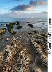 Landscape looking out to sea with rocky coastline and...