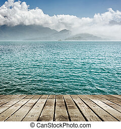 lake with wooden ground