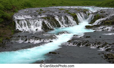 Landscape of Bruarfoss waterfall in Brekkuskogur, Iceland. Bruarfoss waterfall is the famous waterfall attracting tourist who visit route of Iceland Golden Circle.