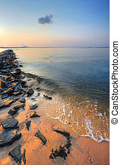 Chesapeake bay beach and jetty at sunset - Landscape of...
