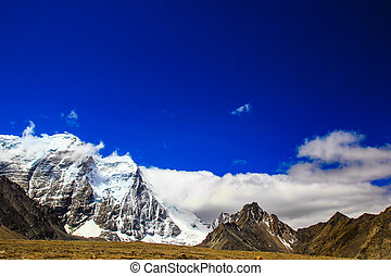 Landscape of deep blue sky and ice capped peaks of himalayan...