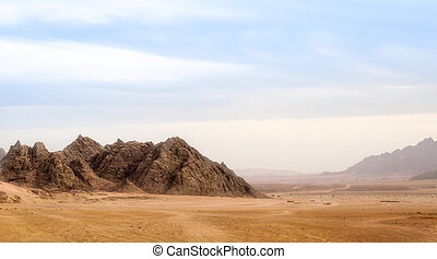 landscape of desert and high rocky mountains against the blue sky and clouds in Egypt in Sharm El Sheikh