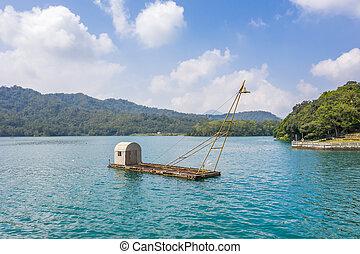 landscape of fishing boat over lake