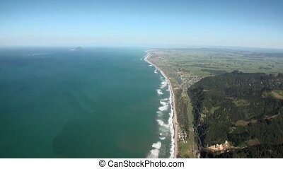 Landscape of green mountain and ocean coast view from helicopter in New Zealand.