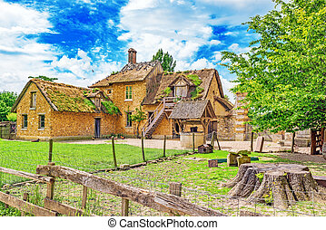 Landscape of hamlet Queen Marie Antoinette's estate near Versailles Palace. Palace Versailles -most beautiful palace in France.