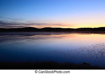 Landscape of lake sunrise at dawn