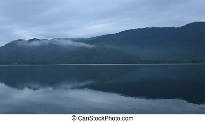 landscape of mountain with fog floating in lake