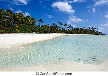 Beautiful sandbank on Maina Island in Aitutaki Lagoon Cook Islands.